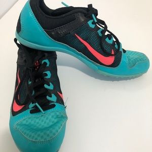 Nike running shoes with spikes 8.5
